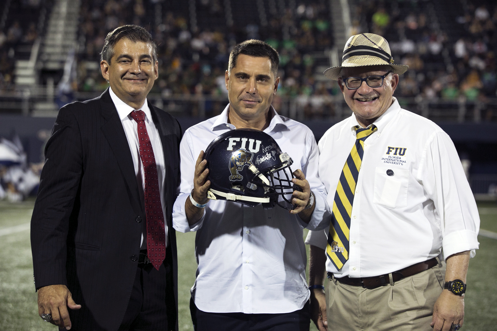 Riccardo Silva being recognised for his continued support for FIU by Pete Garcia, FIU Athletics Department Director and the President of FIU, Mark Rosenberg