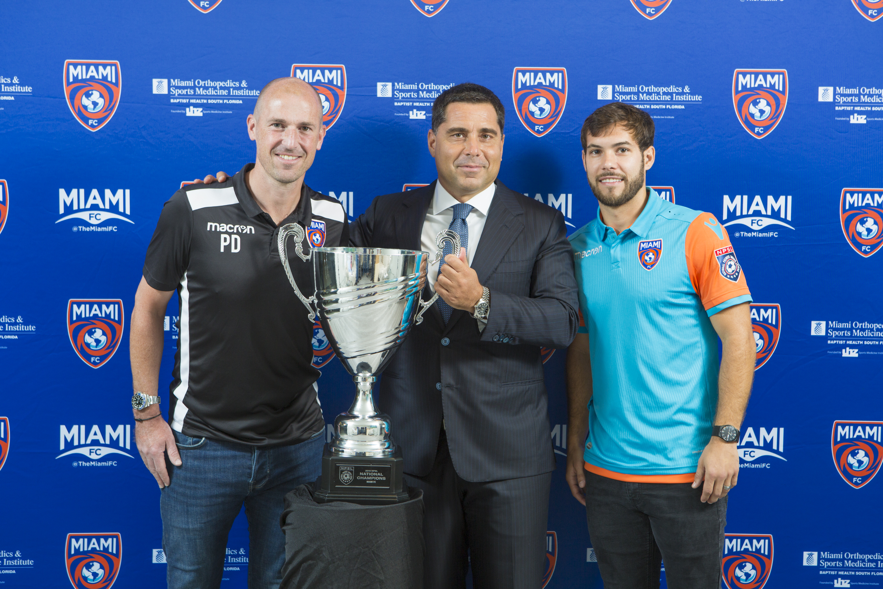 Riccardo Silva with The Miami FC Coach Paul Dalglish and Captain Dylan Mares celebrating The Miami FC winning the 2019 NPSL National Championship