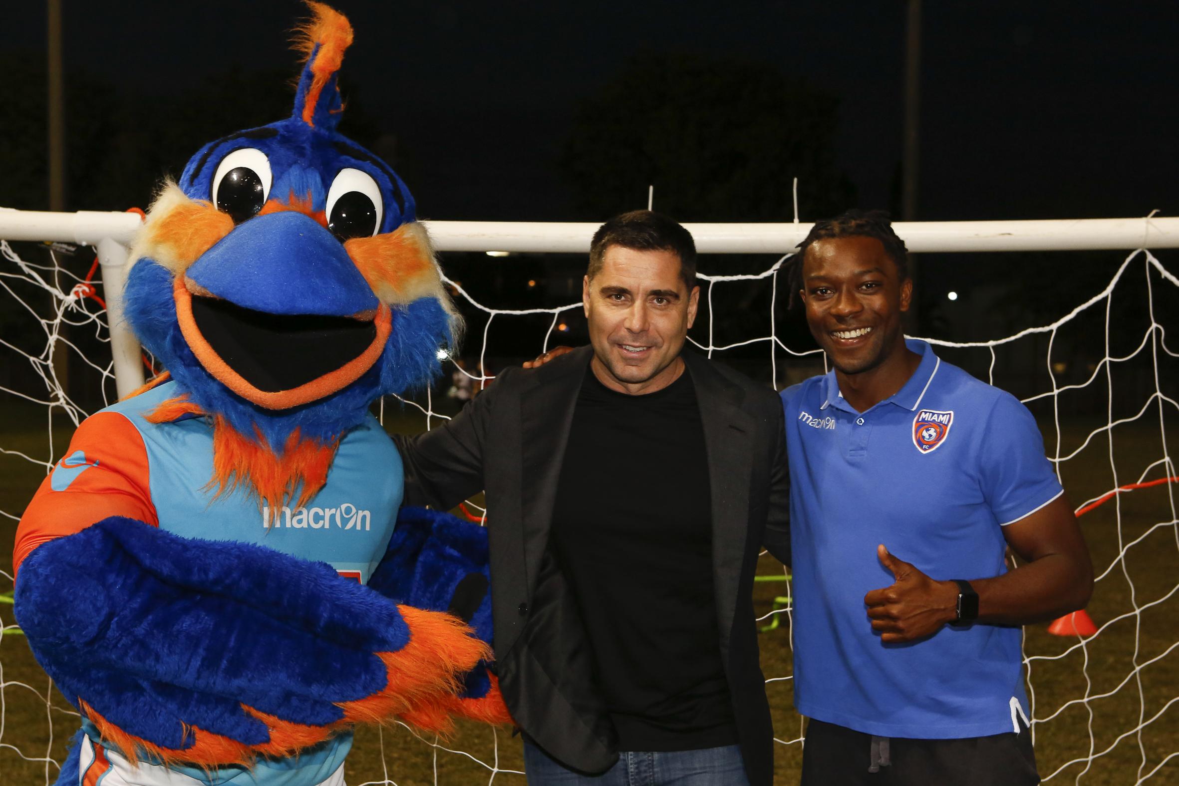 Riccardo Silva with Miami FC mascot Golazo and captain Michael Lahoud