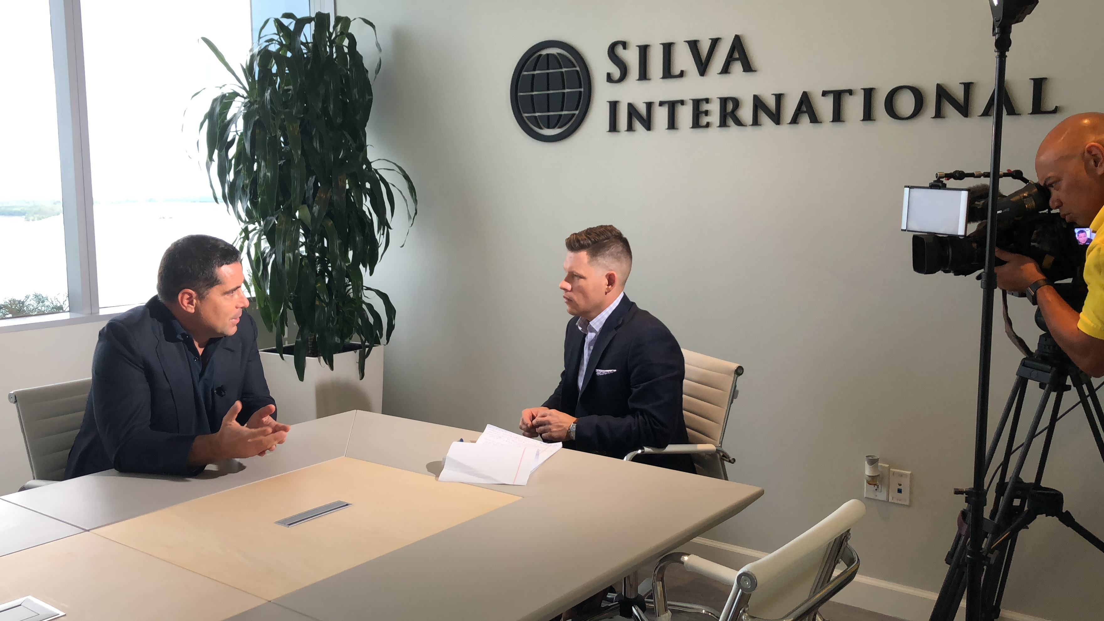 Riccardo Silva and NBC6's Chris Fisher discussing the current state of soccer in the US at the Silva International Investments office in Miami